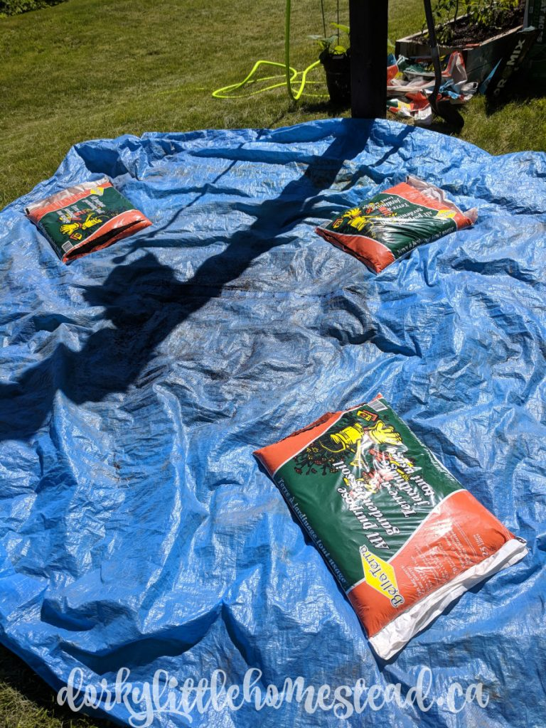 Soil bags ready to dump onto the tarp