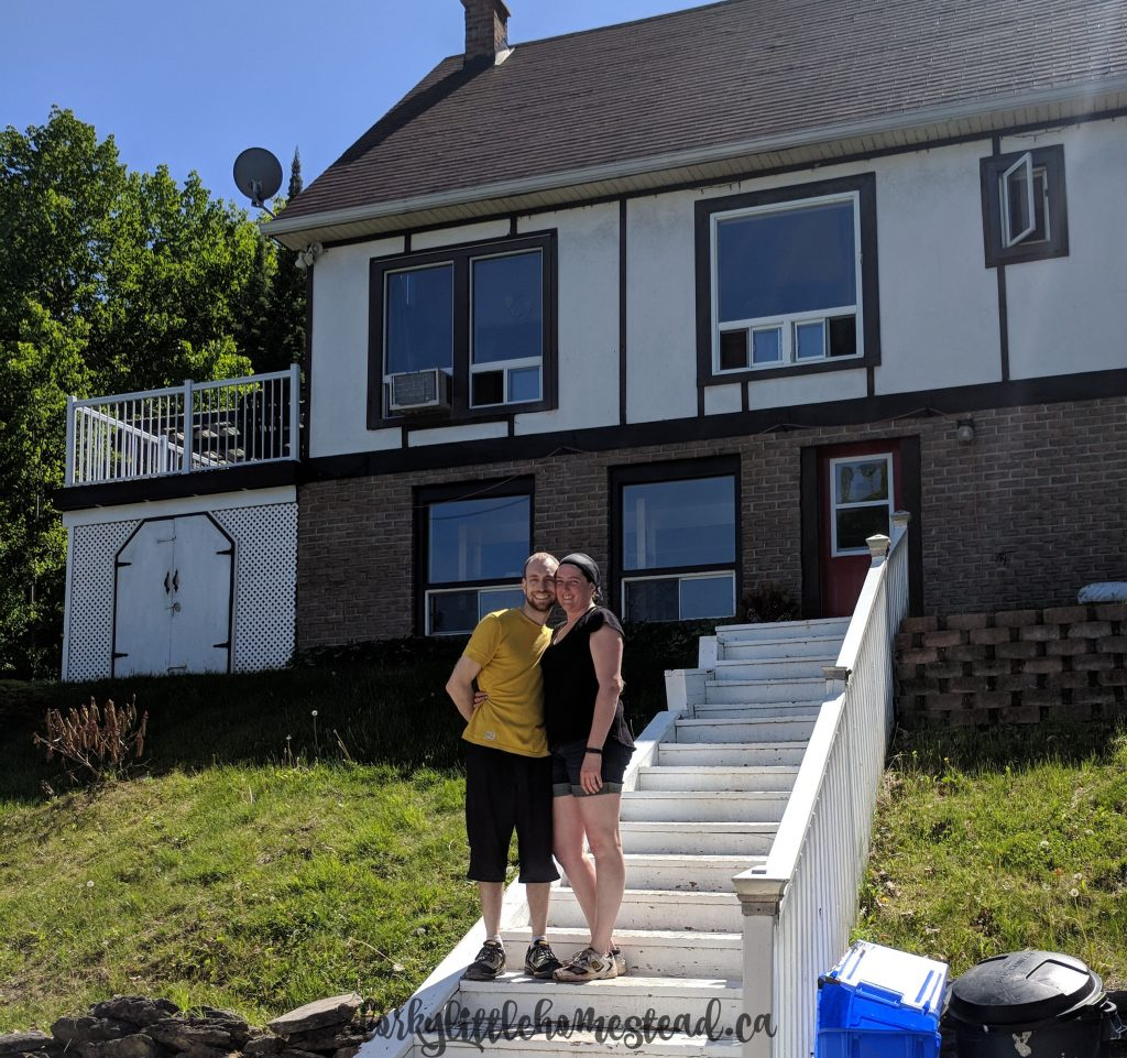 Mike and I standing in front of our new house 18 months ago!
